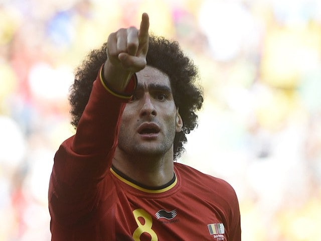 Belgium's midfielder Marouane Fellaini celebrates after scoring during a Group H football match between Belgium and Algeria on June 17, 2014