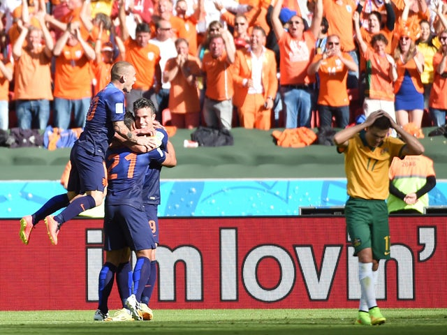 Netherlands' forward Memphis Depay is congratulated after scoring during a Group B football match between Australia and the Netherlands at the Beira-Rio Stadium in Porto Alegre during the 2014 FIFA World Cup on June 18, 2014