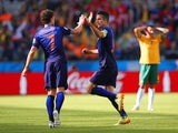 Robin van Persie of the Netherlands celebrates with Daryl Janmaat after scoring the second goal during the 2014 FIFA World Cup Brazil Group B match between Australia and Netherlands at Estadio Beira-Rio on June 18, 2014
