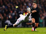 Aaron Smith of New Zealand is tackled by Chris Ashton of England during the International Test match between the New Zealand All Blacks and England at Waikato Stadium on June 21, 2014