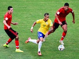 Brazil forward Neymar drives through the Mexico defence during the World Cup Group A match in Fortaleza on June 17, 2014