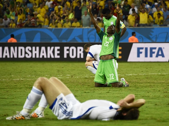 Nigeria's defender Kenneth Omeruo celebrates after winning the Group F football match between Nigeria and Bosnia-Hercegovina at the Pantanal Arena in Cuiaba during the 2014 FIFA World Cup on June 21, 2014