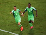 Peter Odemwingie of Nigeria celebrates scoring his team's first goal with teammate Emmanuel Emenike during the 2014 FIFA World Cup Group F match between Nigeria and Bosnia-Herzegovina at Arena Pantanal on June 21, 2014