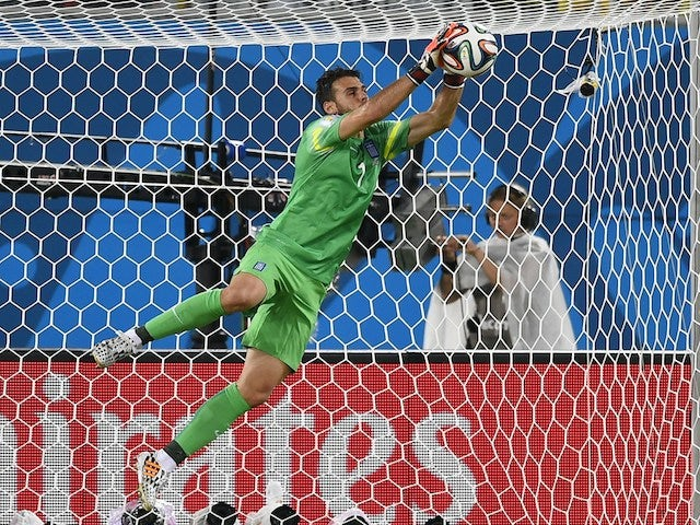 Greece's goalkeeper Orestis Karnezis makes a save during a Group C football match between Japan and Greece at the Dunas Arena in Natal during the 2014 FIFA World Cup on June 19, 2014