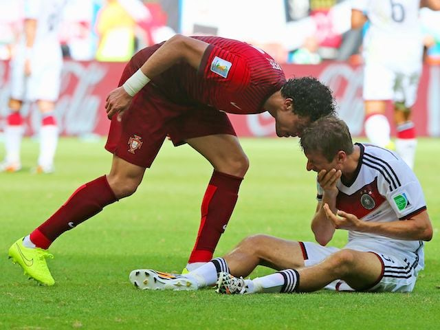 Portugal's Pepe headbutts Thomas Mueller of Germany during their World Cup encounter on June 16, 2014.