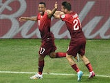 Portugal's forward Nani celebrates with Portugal's defender Joao Pereira after scoring during a Group G football match between USA and Portugal at the Amazonia Arena in Manaus during the 2014 FIFA World Cup on June 22, 2014