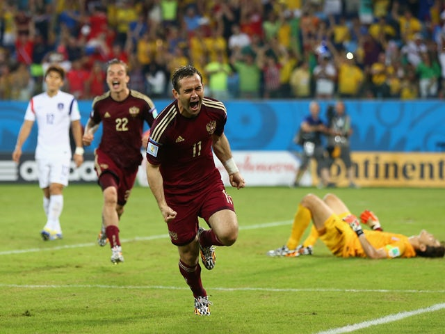 Aleksandr Kerzhakov of Russia celebrates scoring his team's first goal during the 2014 FIFA World Cup Brazil Group H match between Russia and South Korea at Arena Pantanal on June 17, 2014