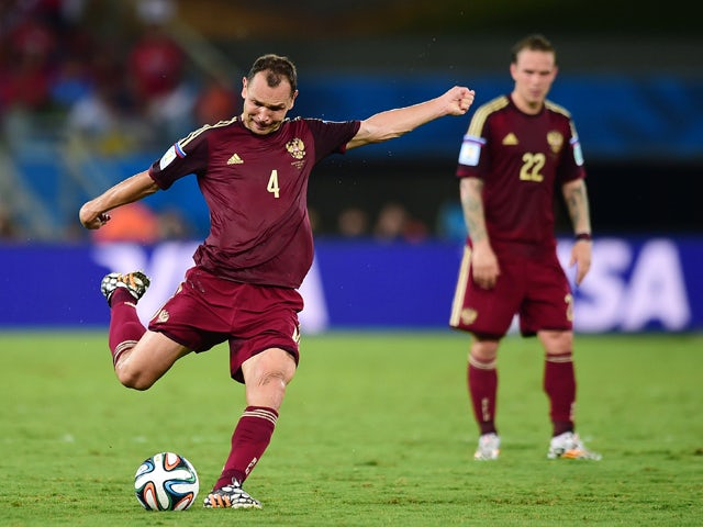 Russia's defender and captain Sergey Ignashevich kicks the ball during a Group H football match between Russia and South Korea in the Pantanal Arena in Cuiaba during the 2014 FIFA World Cup on June 17, 2014