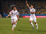 Lee Keun-Ho of South Korea celebrates scoring his team's first goal with Lee Chung-Yong during the 2014 FIFA World Cup Brazil Group H match between Russia and South Korea at Arena Pantanal on June 17, 2014