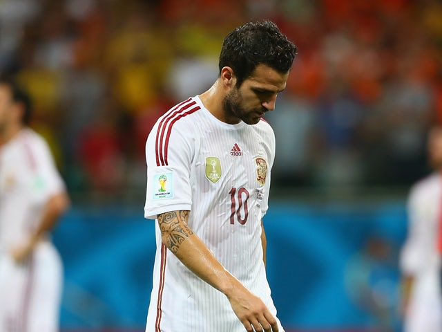 A dejected Cesc Fabregas of Spain looks on during the 2014 FIFA World Cup Brazil Group B match between Spain and Netherlands at Arena Fonte Nova on June 13, 2014