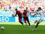 Thomas Muller scores from the penalty spot to give Germany the lead against Portugal in their World Cup Group G match in Salvador on June 16, 2014