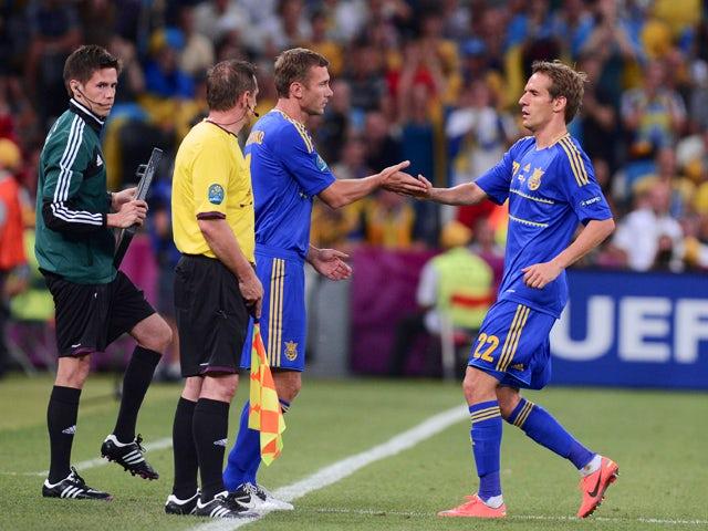 Ukrainian forward Andriy Shevchenko replaces Ukrainian forward Marko Devic during the Euro 2012 football championships match England vs Ukraine on June 19, 2012