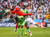Vincent Enyeama of Nigeria makes a save over teammates Joseph Yobo and Ashkan Dejagah of Iran during the 2014 FIFA World Cup Brazil Group F match on June 16, 2014