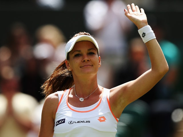 Agnieszka Radwanska of Poland celebrates after her Ladies' Singles second round match against Casey Dellacqua of Australia on day three of the Wimbledon Lawn Tennis Championships at the All England Lawn Tennis and Croquet Club at Wimbledon on June 25, 201