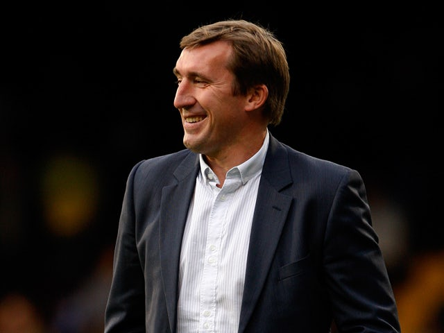 Former Everton player Alan Stubbs walks across the picth before the second half of the Premier Academy League Final match between Fulham and Everton at Craven Cottage on May 13, 2011