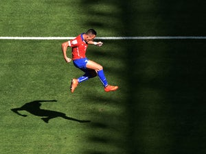 Chile forward Alexis Sanchez celebrates after scoring the equaliser against Brazil in their World Cup last-16 match in Belo Horizonte on June 28, 2014