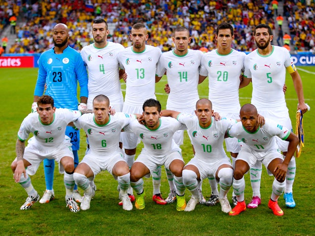 Algeria pose for a team photo prior to the 2014 FIFA World Cup Brazil Group H match between Algeria and Russia at Arena da Baixada on June 26, 2014