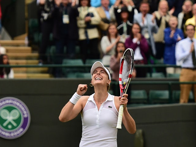 France's Alize Cornet celebrates after winning her women's singles third round match against US player Serena Williams on day six of the 2014 Wimbledon Championships at The All England Tennis Club in Wimbledon, southwest London, on June 28, 2014