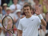 Russia's Andrey Kuznetsov celebrates beating Spain's David Ferrer during their men's singles second round match on day three of the 2014 Wimbledon Championships at The All England Tennis Club in Wimbledon, southwest London, on June 25, 2014