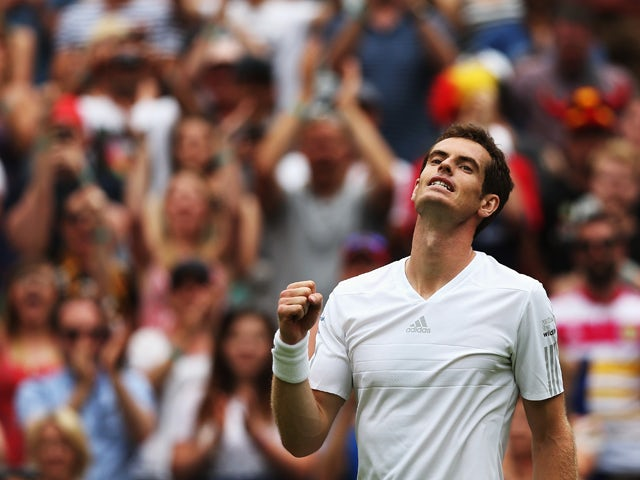 Andy Murray of Great Britain celebrates after winning his Gentlemen's Singles first round match against David Goffin of Belgium on day one of the Wimbledon Lawn Tennis Championships at the All England Lawn Tennis and Croquet Club at Wimbledon on June 23,