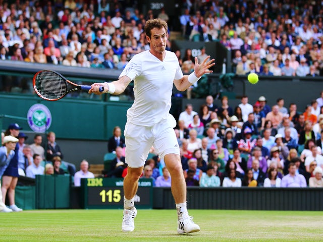Andy Murray of Great Britain plays a forehand return during his Gentlemen's Singles third round match against Roberto Bautista Agut of Spain on day five of the Wimbledon Lawn Tennis Championships at the All England Lawn Tennis and Croquet Club on June 27,