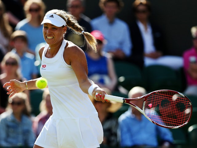 Angelique Kerber of Germany in action during her Ladies' Singles first round match against Urszula Radwanska of Poland on day two of the Wimbledon Lawn Tennis Championships at the All England Lawn Tennis and Croquet Club at Wimbledon on June 24, 2014