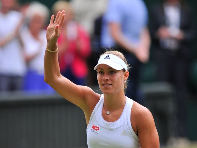 Germany's Angelique Kerber celebrates beating Britain's Heather Watson during their women's singles second round match on day four of the 2014 Wimbledon Championships at The All England Tennis Club in Wimbledon, southwest London, on June 26, 2014