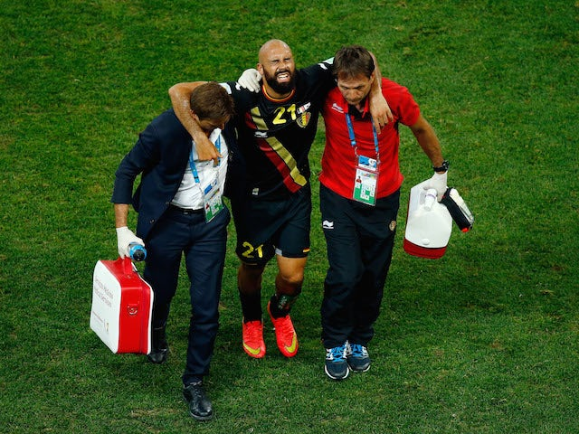 Anthony Vanden Borre of Belgium is helped off the pitch during the 2014 FIFA World Cup Brazil Group H match against South Korea on June 28, 2014