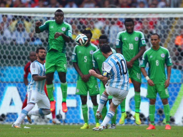 Lionel Messi of Argentina scores his team's second goal and his second of the game during the 2014 FIFA World Cup Brazil Group F match between Nigeria and Argentina at Estadio Beira-Rio on June 25, 2014