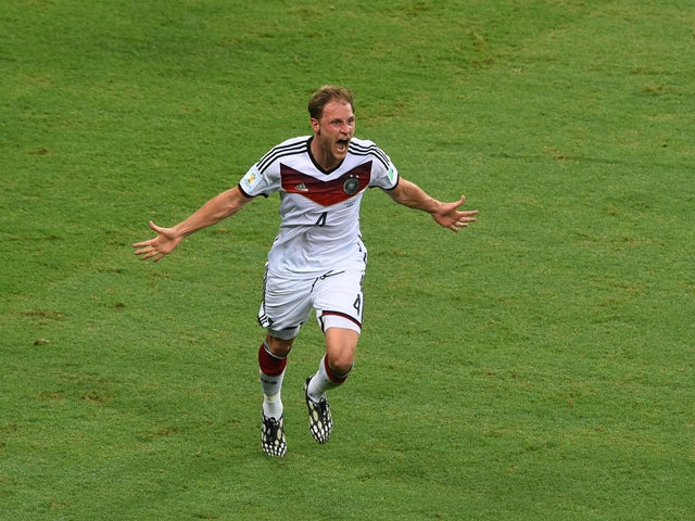 Benedikt Howedes of Germany celebrates after his team's second goal during the 2014 FIFA World Cup Brazil Group G match between Germany and Ghana at Castelao on June 21, 2014