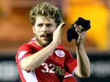 Crawley goal scorer Billy Clarke celebrates on the final whistle during the Sky Bet League one match against Carlisle United on November 16, 2013