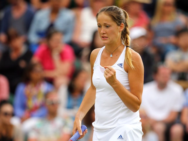 Bojana Jovanovski of Serbia celebrates during her Ladies' Singles second round match against Victoria Azarenka of Belarus on day three of the Wimbledon Lawn Tennis Championships at the All England Lawn Tennis and Croquet Club at Wimbledon on June 25, 2014