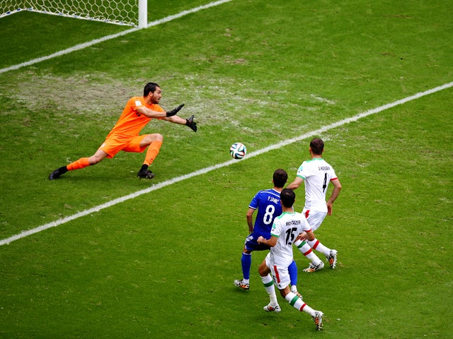Miralem Pjanic of Bosnia and Herzegovina shoots and scores his team's second goal past goalkeeper Alireza Haghighi of Iran during the 2014 FIFA World Cup Brazil Group F match between Bosnia and Herzegovina and Iran at Arena Fonte Nova on June 25, 2014