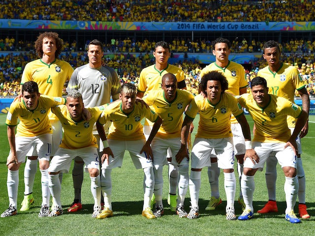 The Brazilian team line up before the game with Chile on June 28, 2014