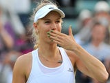 Denmark's Caroline Wozniacki blows a kiss as she celebrates beating Britain's Naomi Broady in their women's singles second round match on day three of the 2014 Wimbledon Championships on June 25, 2014