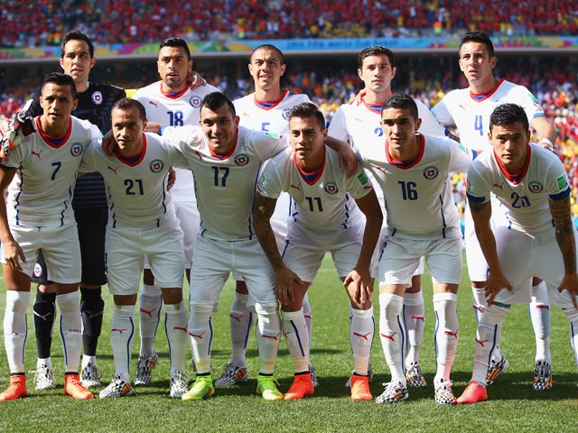 Chile players pose for a team photo prior to the 2014 FIFA World Cup Brazil Group B match between the Netherlands and Chile at Arena de Sao Paulo on June 23, 2014