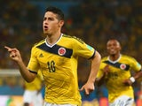 James Rodriguez of Colombia celebrates scoring his team's first goal during the 2014 FIFA World Cup Brazil round of 16 match between Colombia and Uruguay at Maracana on June 28, 2014