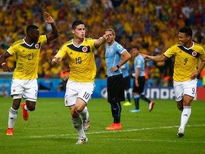 Rodriguez brace fires Colombia into quarters