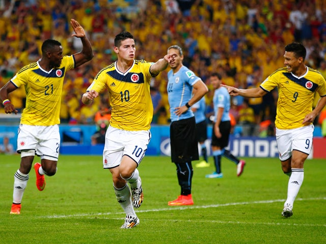 James Rodriguez of Colombia celebrates scoring his team's second goal and his second of the game with teammates Jackson Martinez and Teofilo Gutierrez during the 2014 FIFA World Cup Brazil round of 16 match between Colombia and Uruguay at Maracana on June