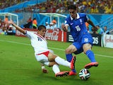 Cristian Gamboa of Costa Rica tackles Lazaros Christodoulopoulos of Greece during the 2014 FIFA World Cup Brazil Round of 16 match between Costa Rica and Greece at Arena Pernambuco on June 29, 2014