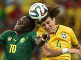 Brazil's defender David Luiz (R) vies with Cameroon's forward Vincent Aboubakar during a Group A football match on June 23, 2014