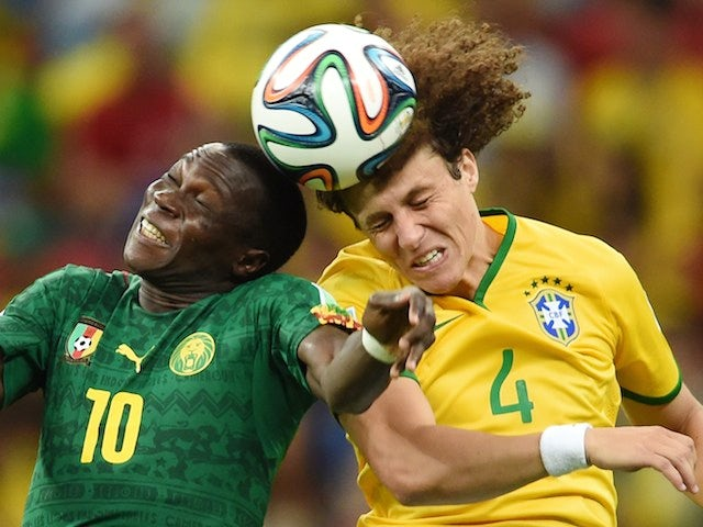 Brazil's defender David Luiz (R) vies with Cameroon's forward Vincent Aboubakar during a Group A football match on June 23, 2014