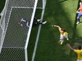 Brazil defender David Luiz wheels away in celebration after scoring the first goal of the World Cup last-16 clash against Chile in Belo Horizonte on June 28, 2014