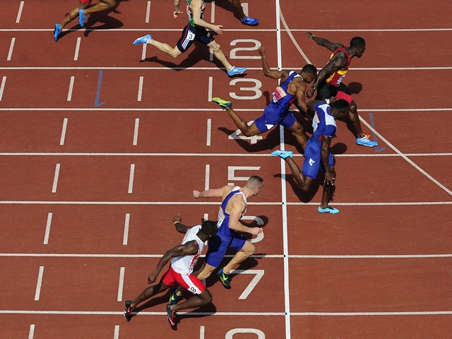 Dwain Chambers celebrates after winning the Men's 100m Final during day three of the Sainsbury's British Championships at Birmingham Alexander Stadium on June 29, 2014