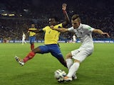 France's defender Lucas Digne in action against Ecuador's defender Juan Paredes during a Group E football match between Ecuador and France at the Maracana Stadium in Rio de Janeiro during the 2014 FIFA World Cup on June 25, 2014