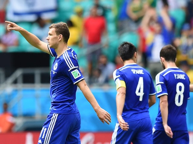 Bosnia striker Edin Dzeko celebrates after scoring the first goal against Iran during their World Cup Group F match on June 25, 2014