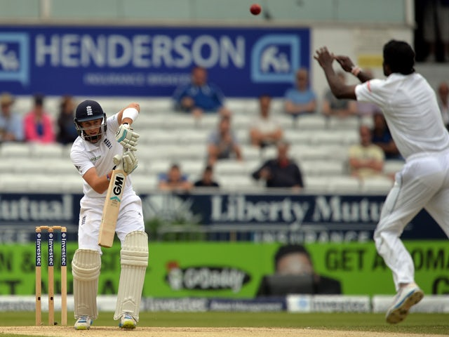 England's Joe Root plays a shot during the fifth and final days play in the second Test cricket match between England and Sri Lanka at Headingley in Leeds, England on June 24, 2014