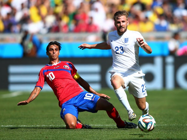 Luke Shaw of England is challenged by Bryan Ruiz of Costa Rica during the 2014 FIFA World Cup Brazil Group D match between Costa Rica and England at Estadio Mineirao on June 24, 2014