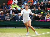 Eugenie Bouchard of Canada durign her Ladies' Singles third round match against Andrea Petkovic of Germany on day six of the Wimbledon Lawn Tennis Championships at the All England Lawn Tennis and Croquet Club at Wimbledon on June 28, 2014