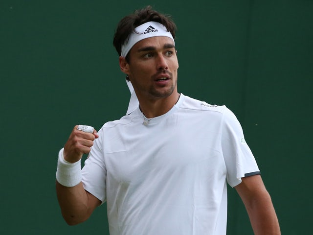 Italy's Fabio Fognini celebrates beating US player Alex Kuznetsov during their men's singles first round match on day one of the 2014 Wimbledon Championships at The All England Tennis Club in Wimbledon, southwest London, on June 23, 2014